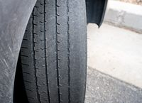 Bald front wheel tires on vehicle needing replacement