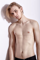 Young blonde man posing