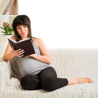 pregnant woman reading book
