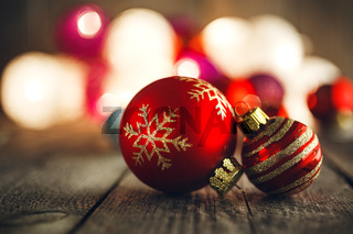 Christmas Baubles on rustic wooden board