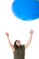 Happy young girl with a giant blue balloon