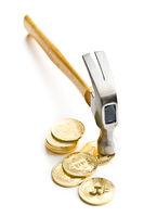 Golden bitcoins and hammer.