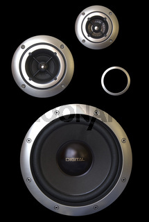 Three speakers and a passive radiator isolated on a black background