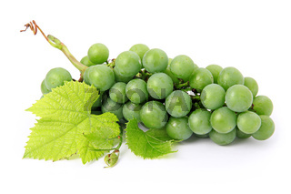 Fresh grape fruits with green leaves isolated