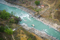 Aerial view of small suspension bridge in Nepal