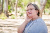 Upset Senior Woman Sitting Alone