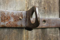 Old wooden door with rusty screw 20555