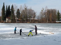 Ice hockey as winter sport on a frozen lake