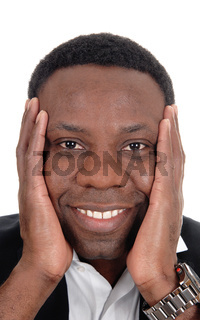 Happy African man with hands on face