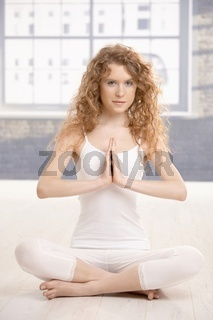 Attractive female practicing yoga prayer pose