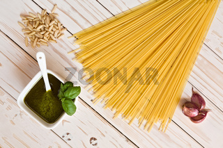Pesto genovese and linguine pasta, pine nuts and garlic on a table