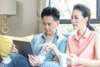 Young Couples using tablet