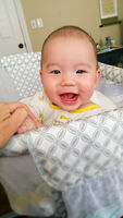 Adorable Chinese and Caucasian Baby Boy Playing In His Crib.