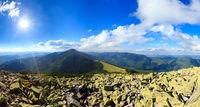 Summer sunshiny Carpathian mountain panorama.