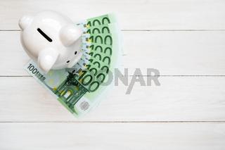 Piggy bank with hundred euro bills