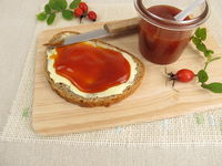 Sliced bread with rose hip jam for breakfast