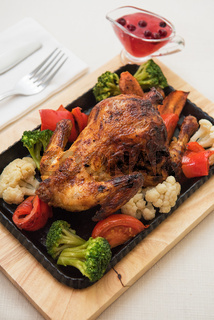 Roasted chicken with vegetables.