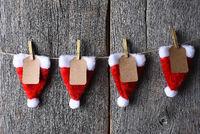 Advent Calendar made of Santa hats clothes pins and string.