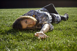 Cute Blond Girl Lying Back On Grass