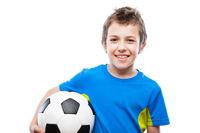 Handsome smiling child boy holding soccer ball