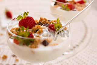 Close up of dessert with strawberries and yogurt