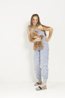 Woman with teddy bear and sleeper suit
