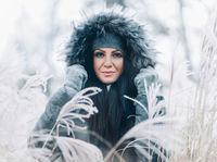 Beautiful young woman wearing a fur hood winter coat