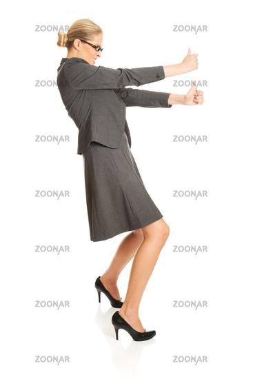 Businesswoman pulling a stick