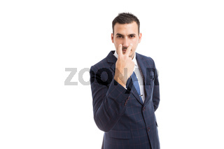 Broker banker or entrepreneur making pay attention gesture