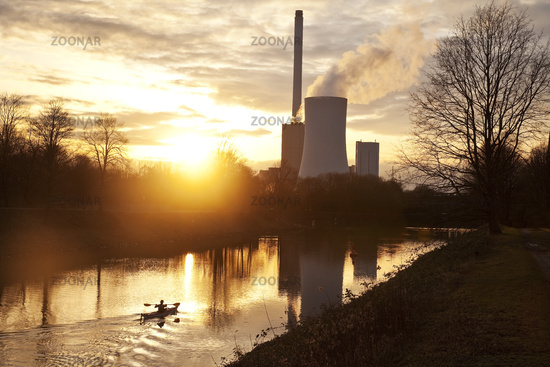 Kayaker on the Rhine-Herne Canal in front of a coal-fired power station in Baukau, Herne, Germany