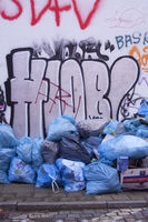 Waste Sacks, Old House Wall a with Graffiti