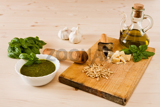 Fresh pesto genovese with its ingredients