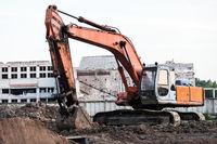 Digging excavator machine at building construction site