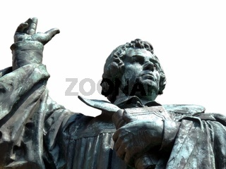 Martin Luther mit Bibel und erhobener Hand als Freisteller