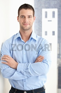 Goodlooking man smiling confidently