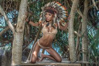 Woman in colourful indian feather hat