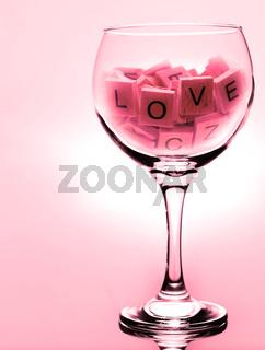 Love sign in wine glass