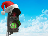 Happy new year 2018. Santa hat on the traffic light with green light 2018.