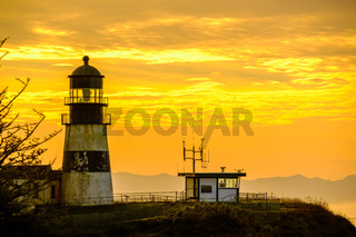 Cape Disappointment Lighthouse at sunrise, built in 1856