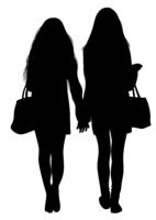 Silhouette of two walking girls holding hands
