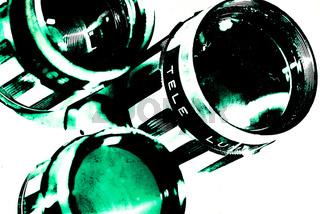 Gruen colorierte Objektive vor weißem Hintergrund