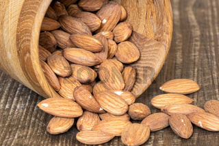 Peeled almonds in a wooden bowl