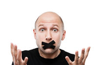 Scared adult man adhesive tape closed mouth