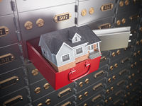 House in opened safe deposit box. Home safety or investment and savings concept.