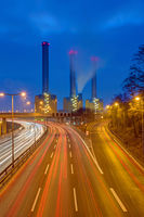 Highway and power station at night seen in Berlin, Germany