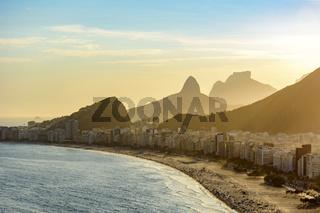 Sunset lights between Copacabana buildings