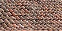 roof tile background - old ceramic tiled roof closeup
