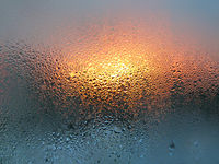 Water drops and sunlight on glass