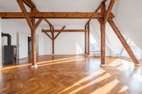 luxury apartment , empty loft room with fireplace and wooden beams