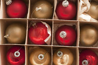 Full frame view of boxed Christmas baubles